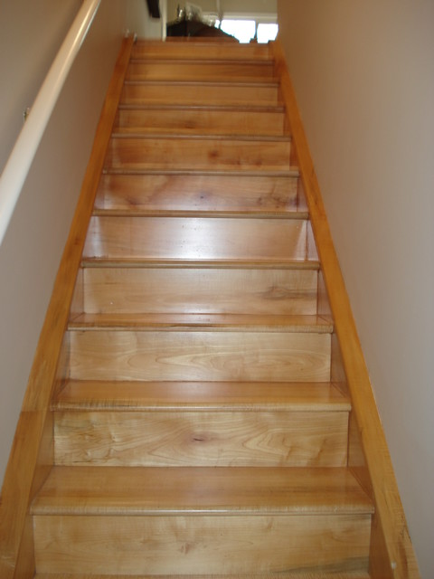 Custom built urban lumber maple stairs traditional-staircase