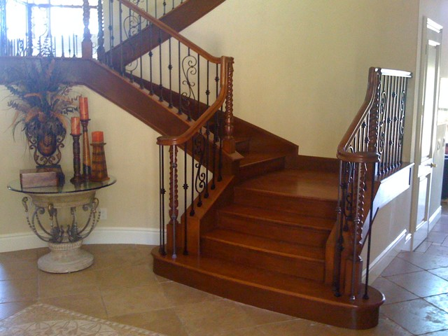 Custom Curved Maple Staircase With Iron Balusters Traditional Staircase