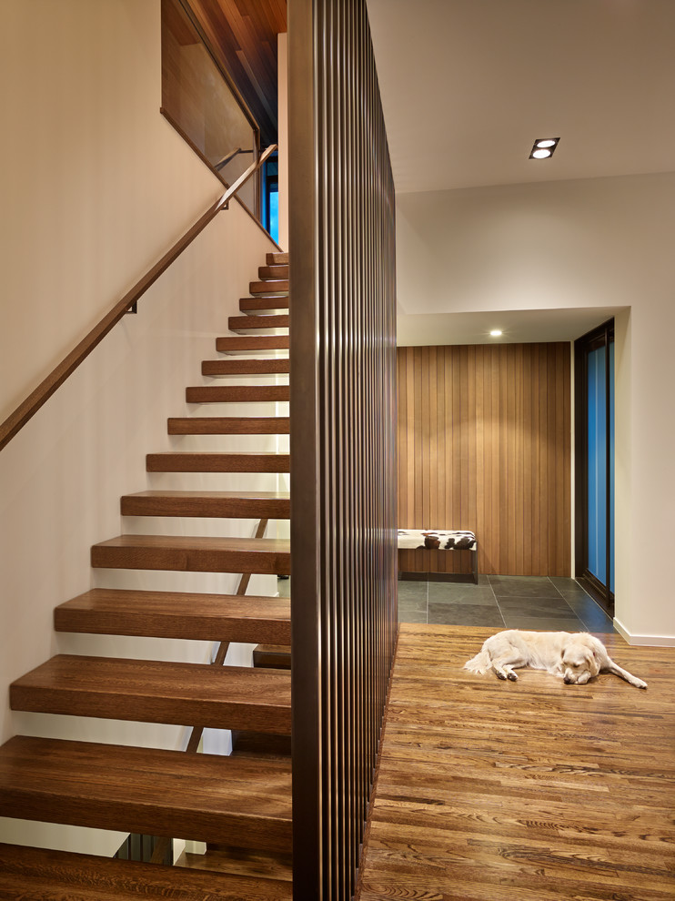 Example of a 1950s wooden straight open staircase design in Seattle