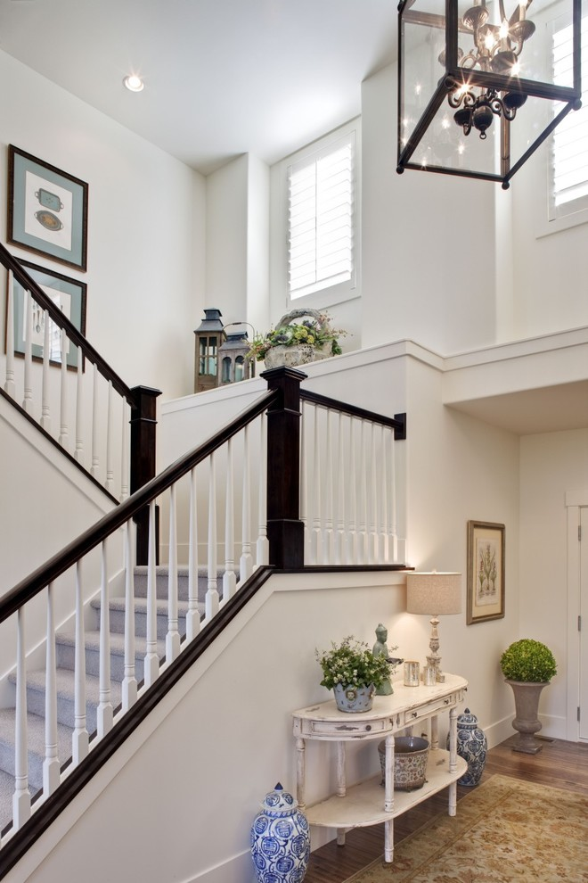 Example of a classic carpeted u-shaped staircase design in Salt Lake City with carpeted risers