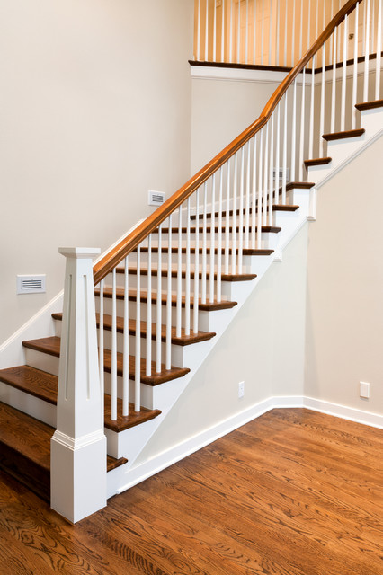 Custom newels traditional-staircase