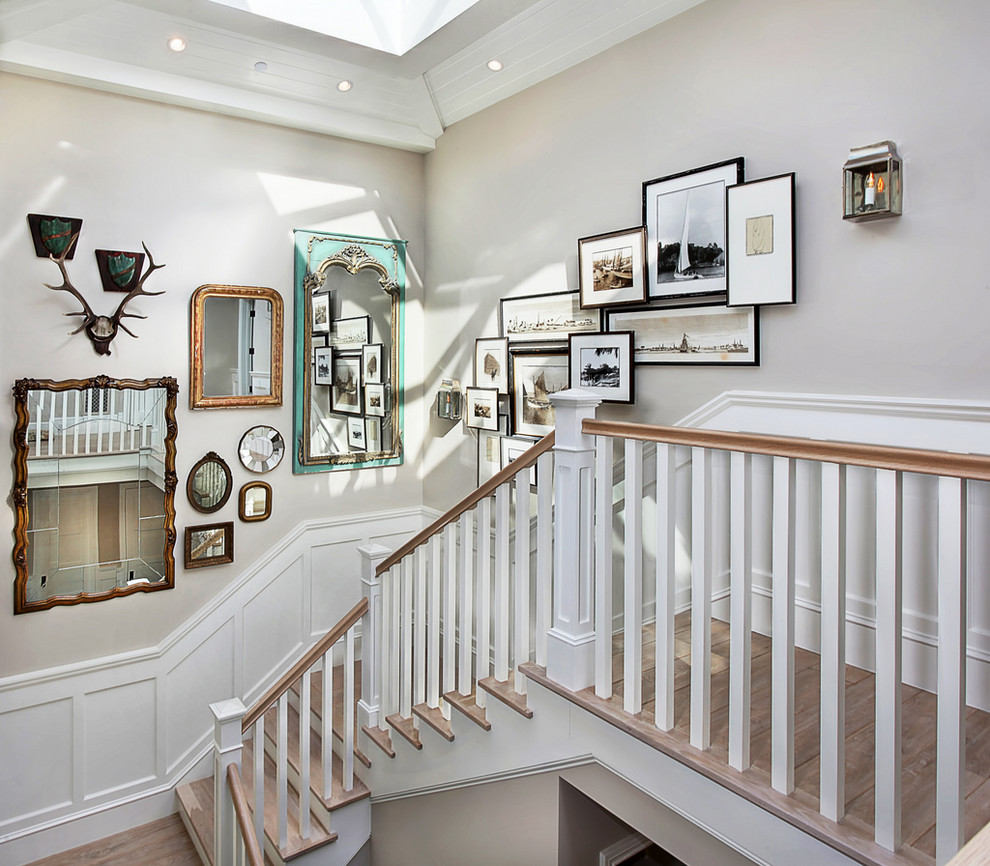 Example of a classic wooden staircase design in Orange County