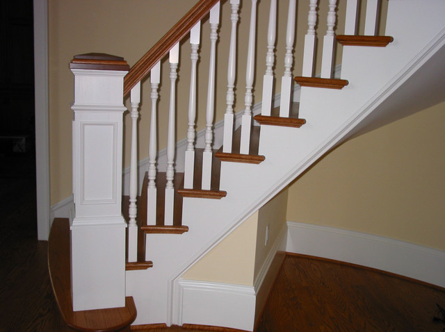 Custom Sweeping Staircase With Wood Spindles