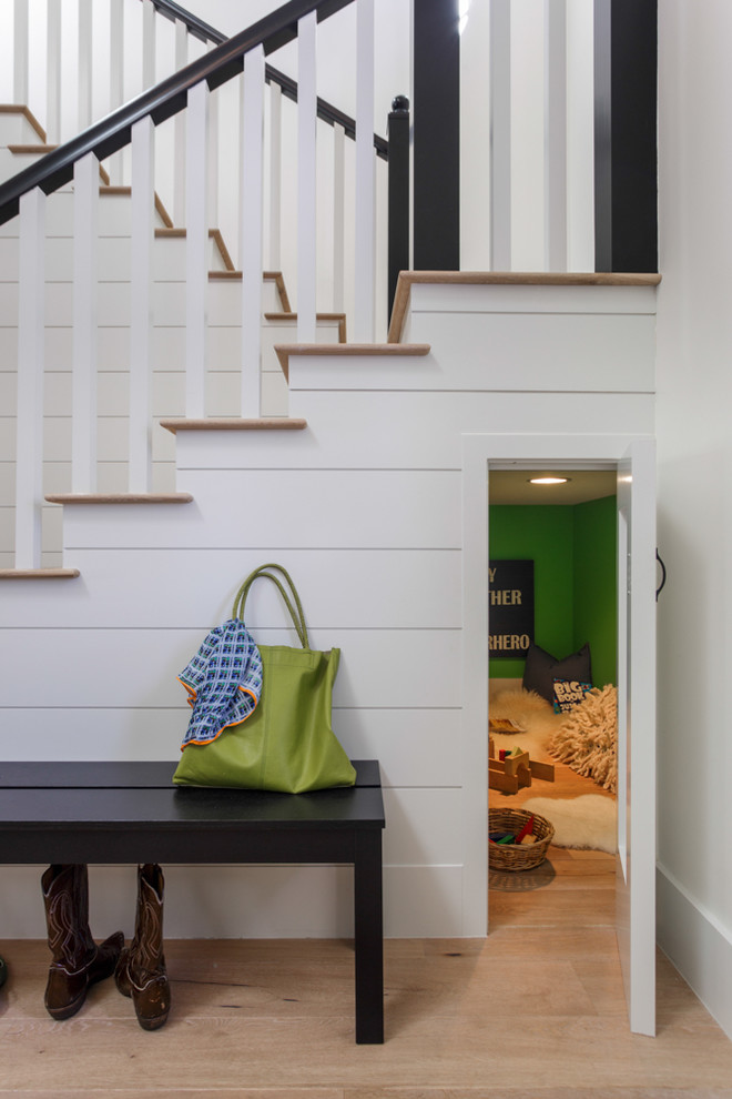 Example of a transitional wooden u-shaped staircase design in Los Angeles