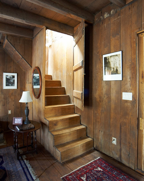 10 stairway design ideas town country living for Country basement ideas