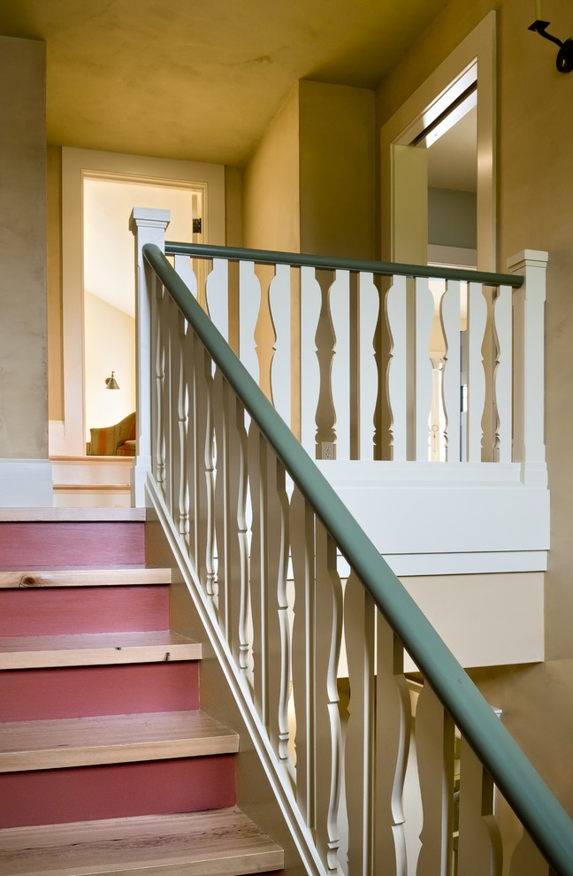 Example of a classic wooden wood railing staircase design in Burlington with painted risers