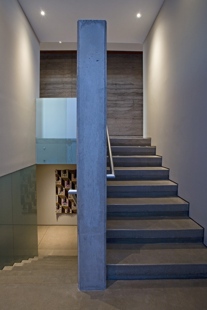Example of a trendy concrete u-shaped staircase design in Phoenix with concrete risers