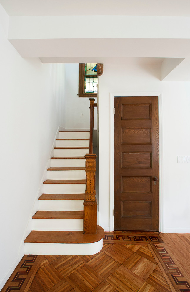 Inspiration for a timeless wooden staircase remodel in New York