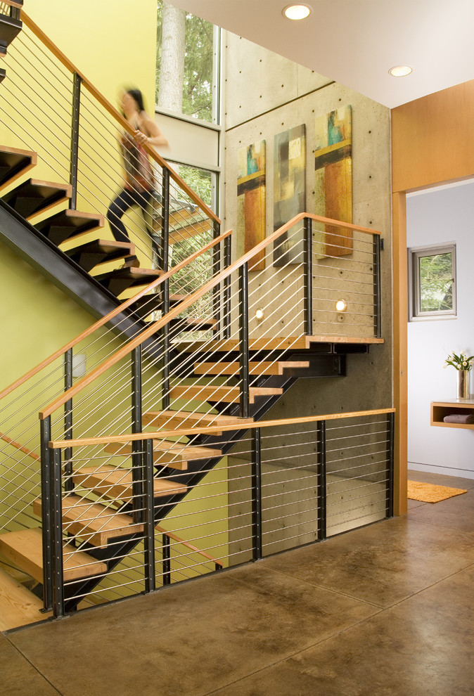 Inspiration for a contemporary open and cable railing staircase remodel in Seattle