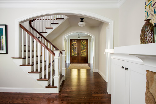 Double Door Entry with Wood Rail Staircase