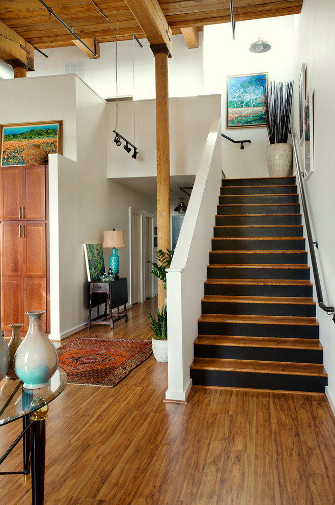 Example of a mid-sized urban wooden l-shaped staircase design in Other with painted risers