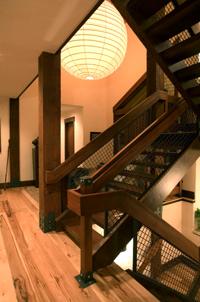 Example of a mountain style wooden u-shaped open and mixed material railing staircase design in Denver