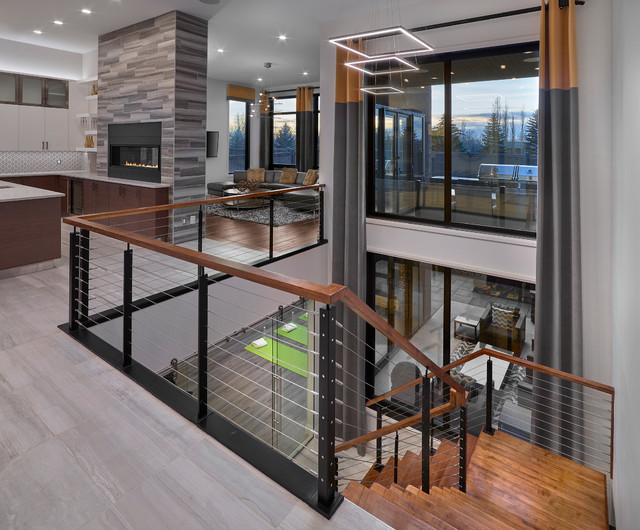 Staircase - large contemporary wooden l-shaped staircase idea in Edmonton with wooden risers