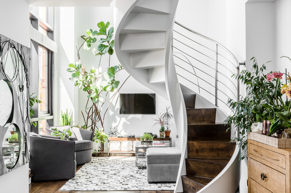 Example of a mid-sized trendy wooden curved staircase design in New York with metal risers