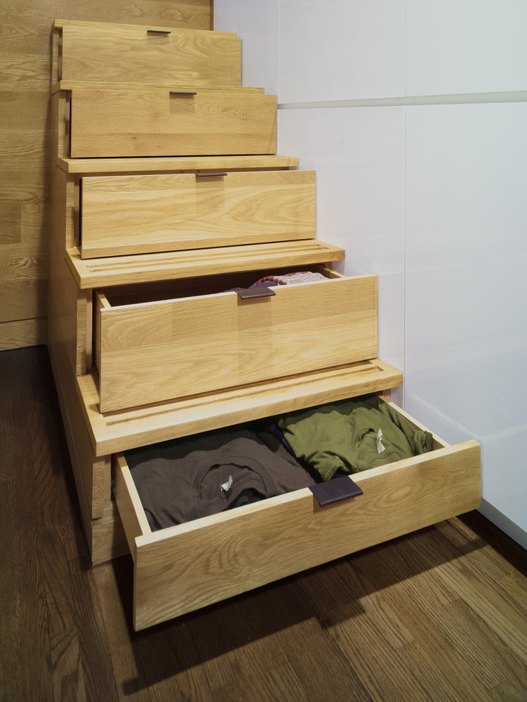 Inspiration for a contemporary wooden staircase remodel in New York with wooden risers