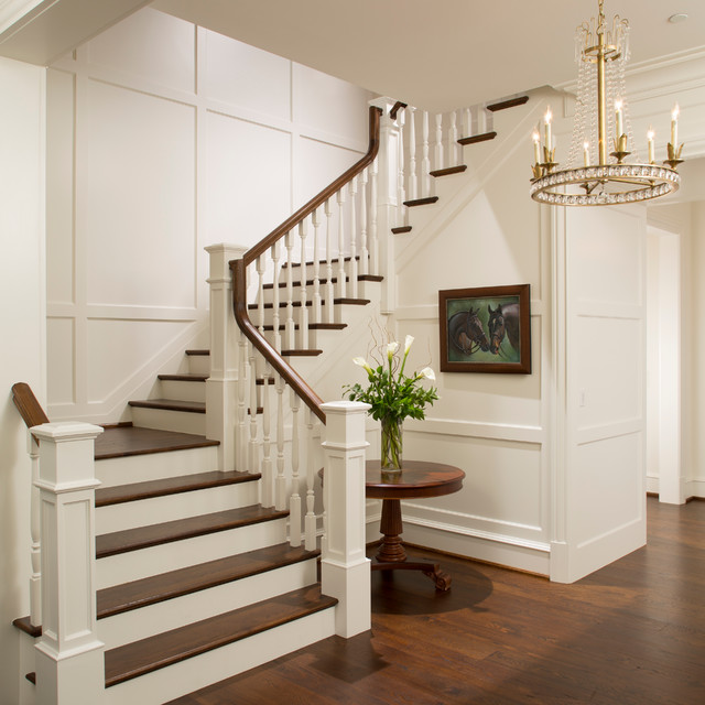 Beautiful Front Hall And Staircase: Elegant Foyer Stair Wraps A Paneled, Two-story Entry Hall