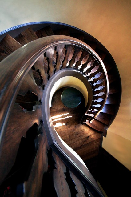 Large elegant wooden spiral staircase photo in Dallas