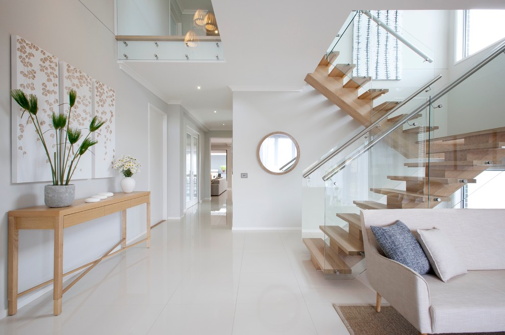 Example of a trendy wooden u-shaped open staircase design in Melbourne
