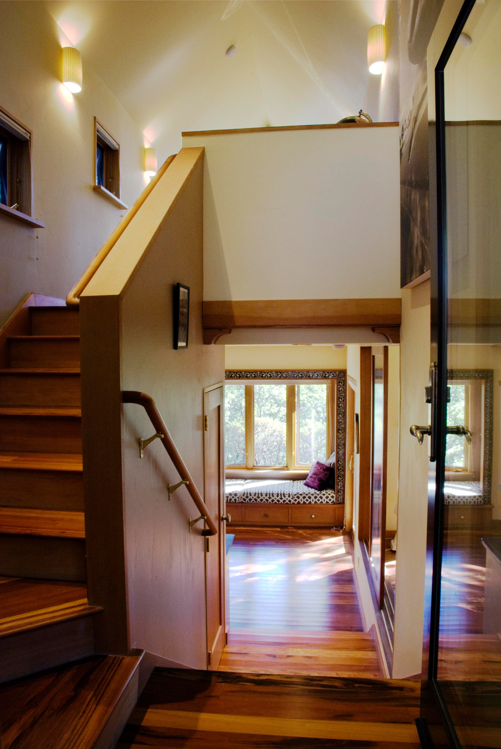 Entry with view to loft above and window seat below