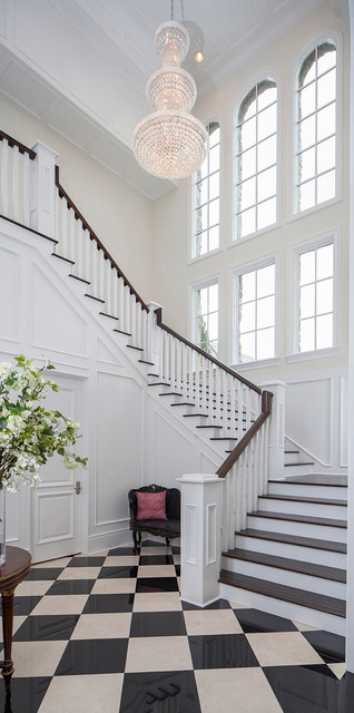 European Inspired Castle on Lake Butler traditional-staircase