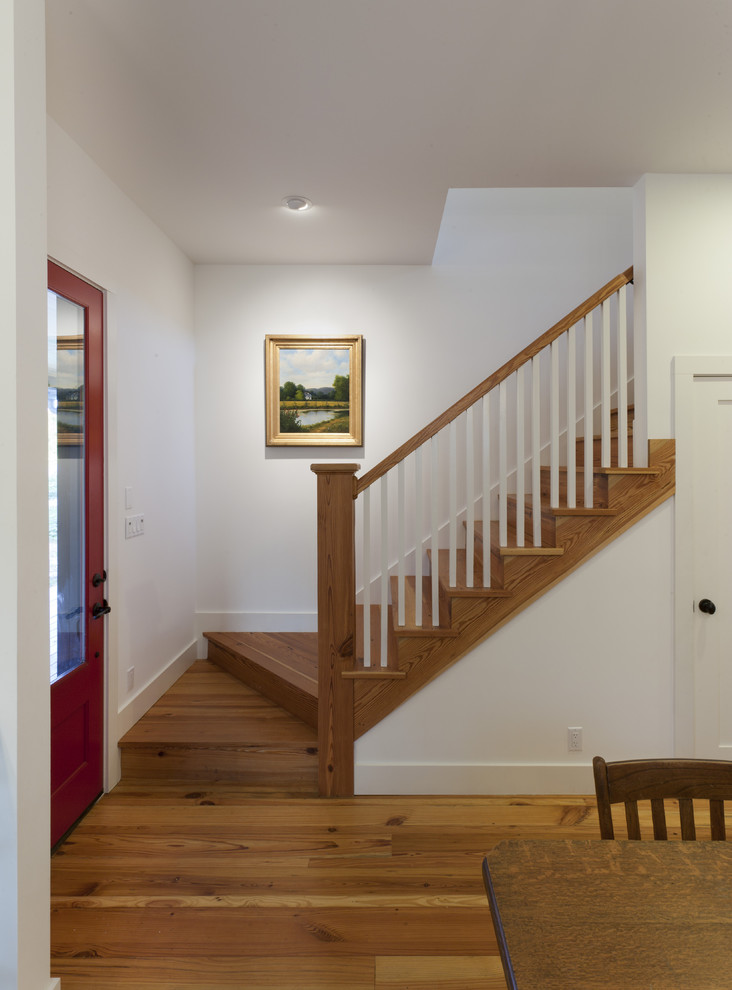 Inspiration for a farmhouse wooden staircase remodel in Austin with wooden risers