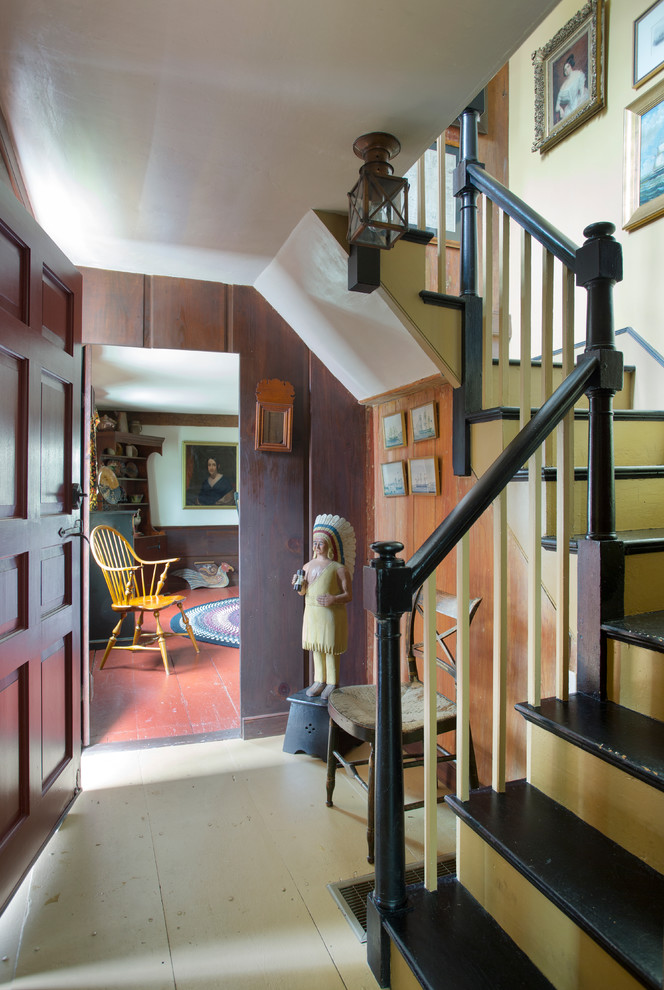 Inspiration for a small country painted u-shaped staircase remodel in Boston with painted risers