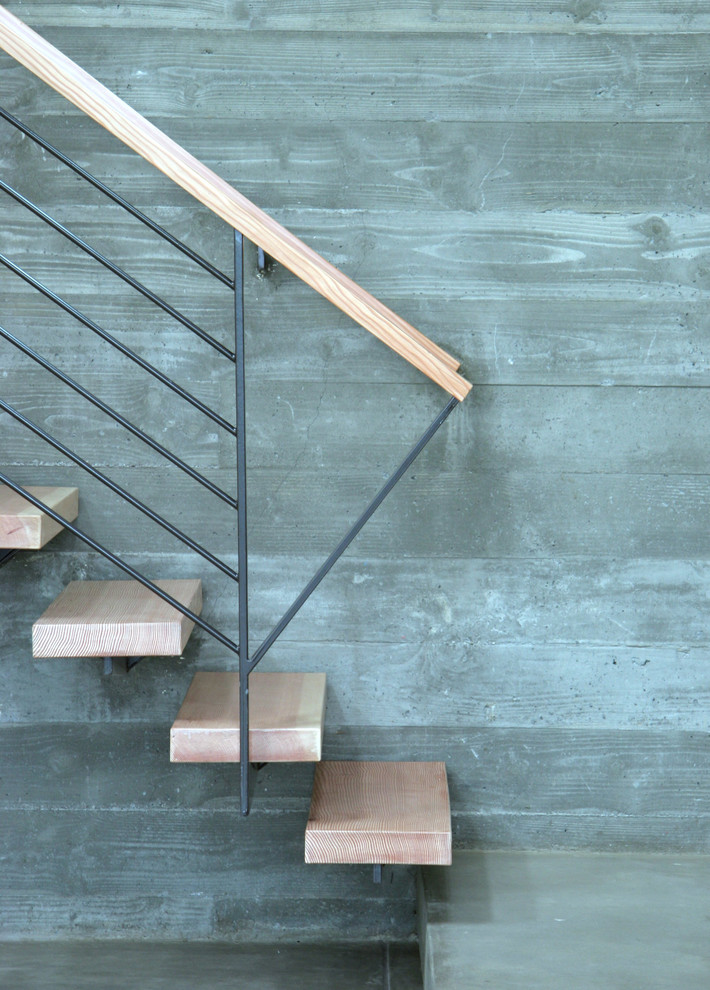 Minimalist wooden floating staircase photo in San Francisco