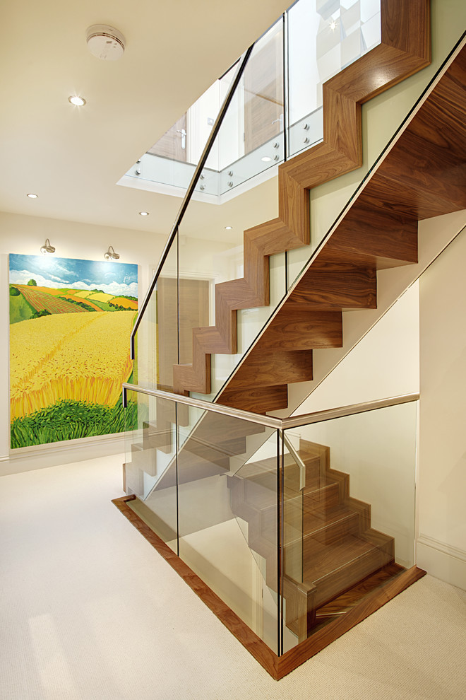 This is an example of a medium sized contemporary wood straight staircase in Other with wood risers.