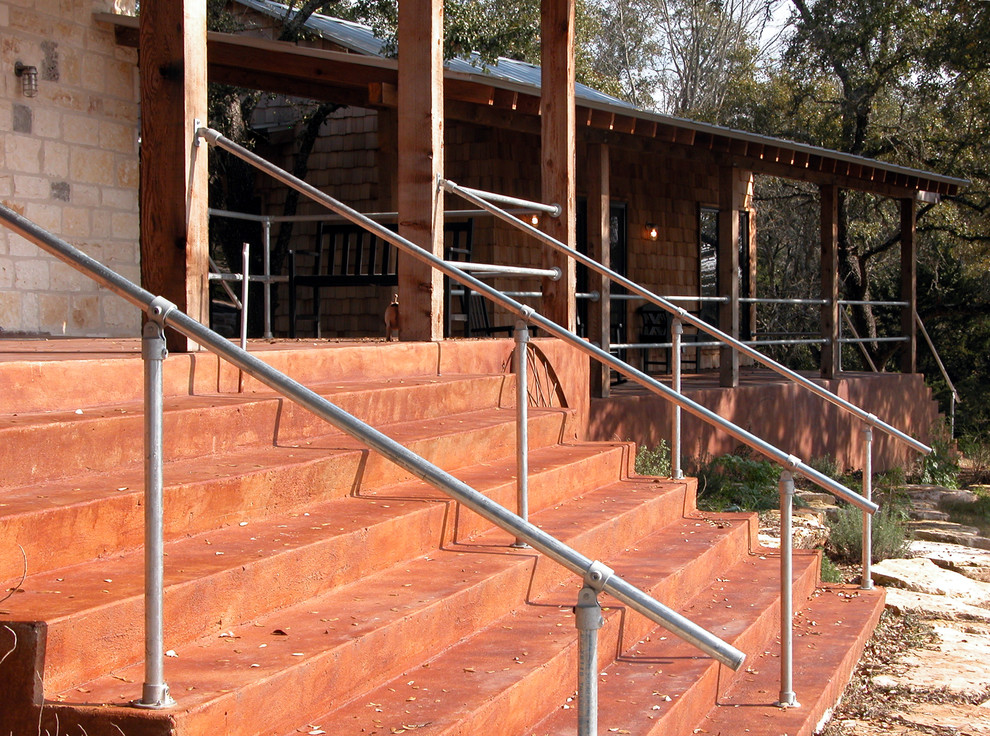 Staircase - industrial staircase idea in Austin