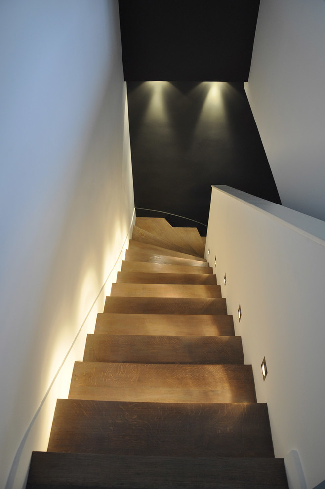 Staircase - modern wooden staircase idea in Other