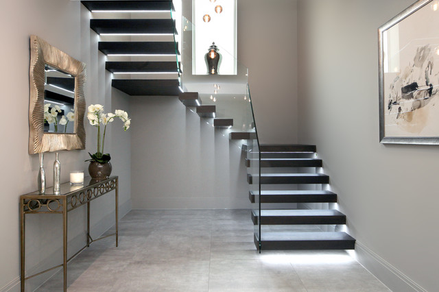 Floating Treads Staircase With Glass Balustrades To The