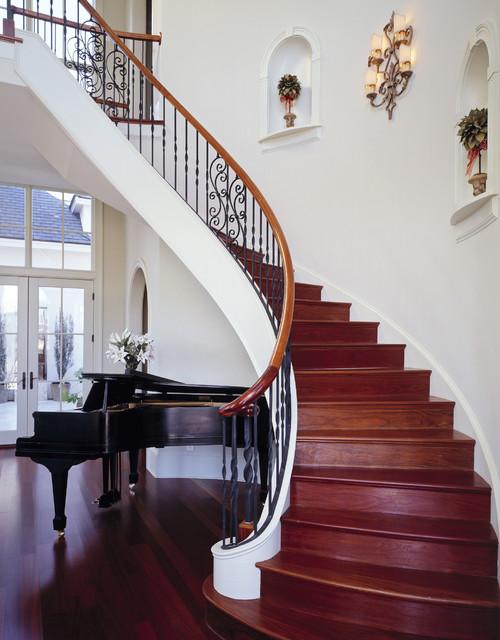 wood clad arched staircase