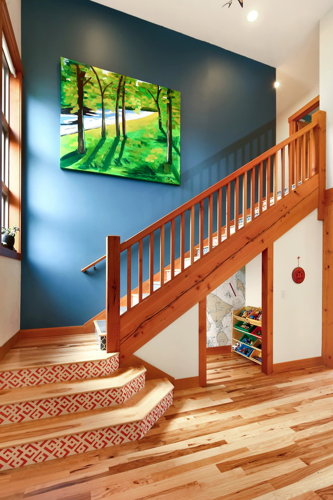 Inspiration for a craftsman wooden straight wood railing staircase remodel in Seattle with wooden risers
