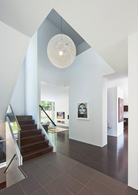 Staircase - contemporary wooden u-shaped staircase idea in Ottawa with wooden risers