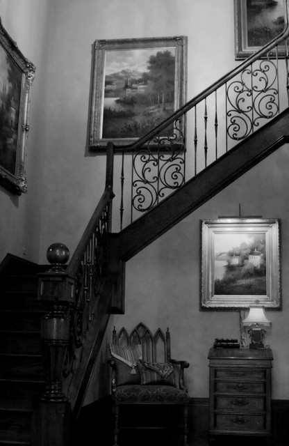 Photo of a large traditional staircase in Dallas.