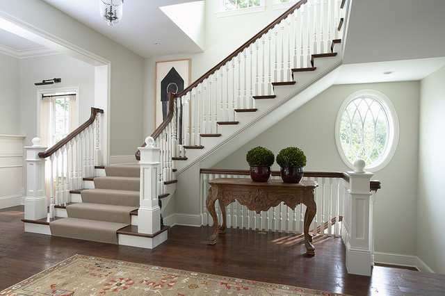 Front Entry and Main Staircase with spiral balusters and oval window traditional staircase