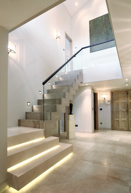 Inspiration for a contemporary wooden l-shaped staircase remodel in London with wooden risers