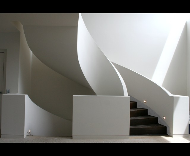 Geometric curved stair with curved dwarf wall balustrade