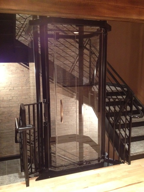 Glass Elevator In Staircase Industrial Staircase