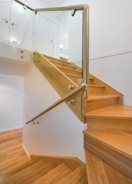 Example of a minimalist wooden u-shaped staircase design in Other with wooden risers