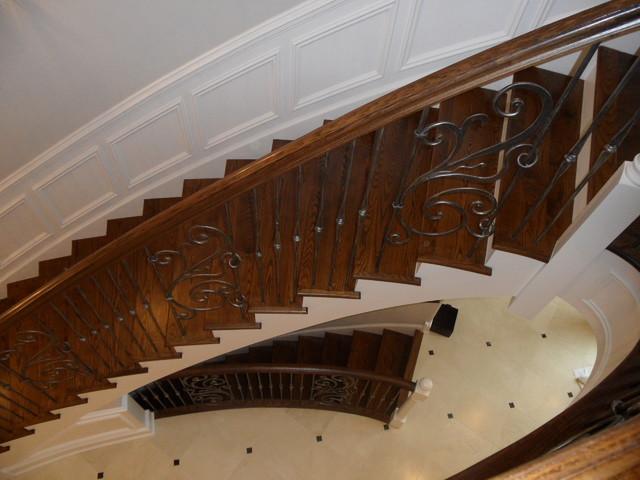 Glencoe Eleptical Staircase Masterpiece mediterranean-staircase