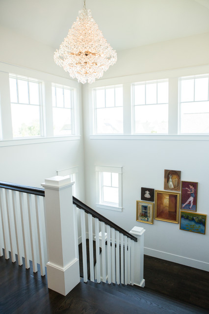 Large transitional wooden u-shaped wood railing staircase photo in Other with wooden risers