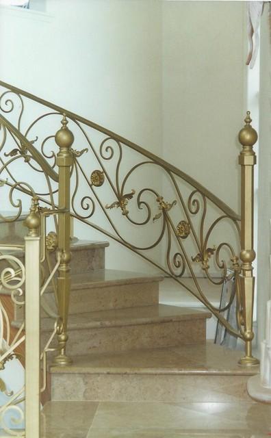 Golden Hand Forged Stair Railing Mediterranean