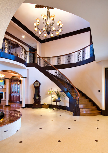 Grand Curved Staircase - Traditional - Staircase ...
