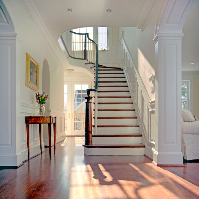 Grand foyer traditional staircase dc metro by for House plans with stairs in foyer