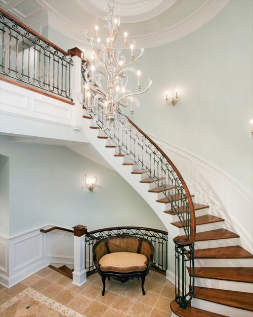 Grand Foyer With Curved Staircase And Chandelier