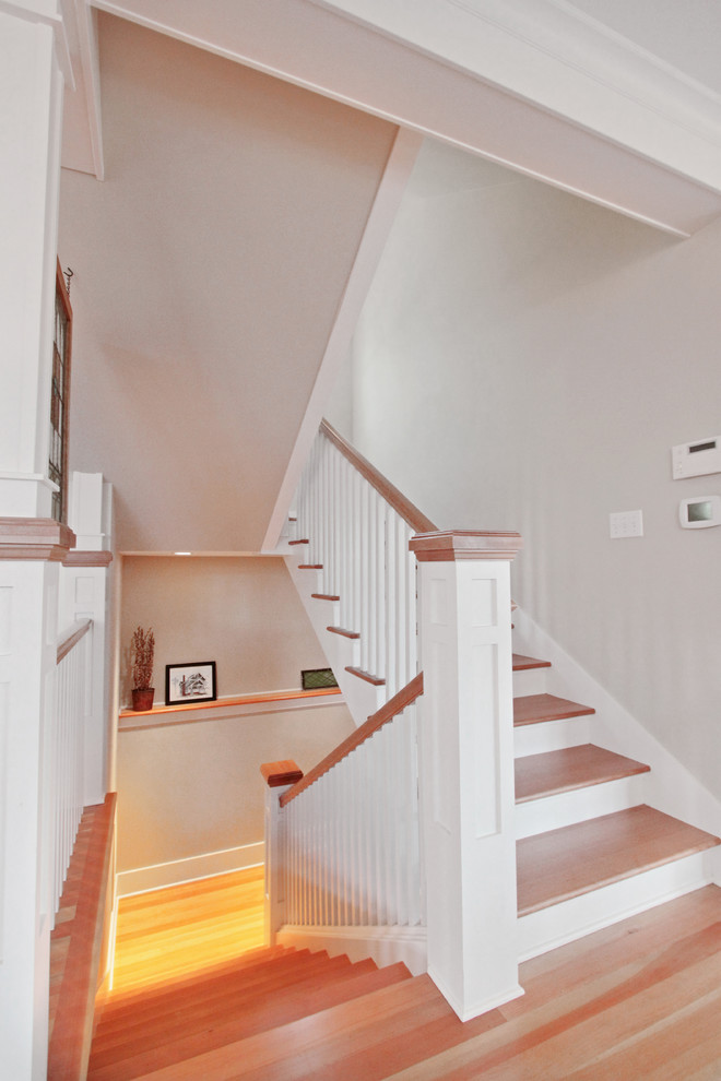 Staircase - mid-sized craftsman wooden u-shaped wood railing staircase idea in Seattle with wooden risers