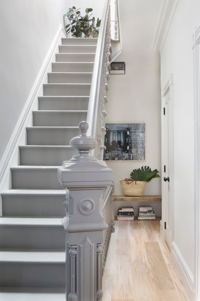Staircase - mid-sized transitional painted l-shaped wood railing staircase idea in New York with painted risers