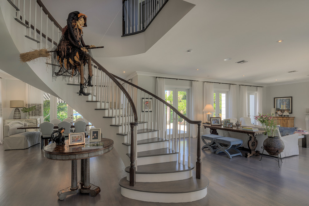 Transitional wooden curved staircase photo in Miami