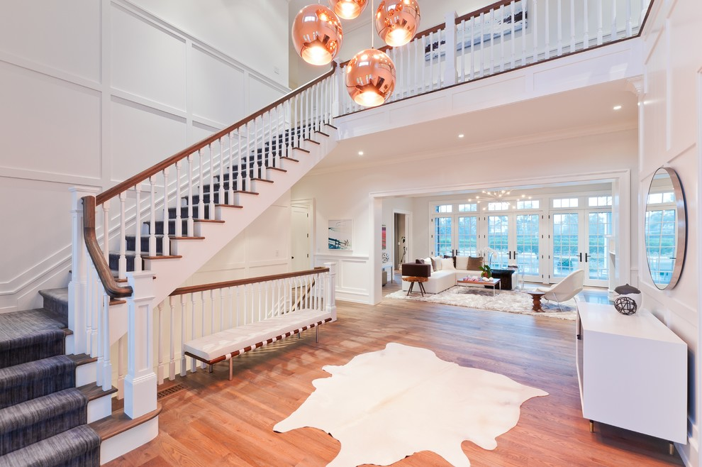Staircase - traditional wooden l-shaped staircase idea in New York
